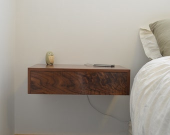 Floating bedside tables in walnut, dovetailed drawers.  nightstand