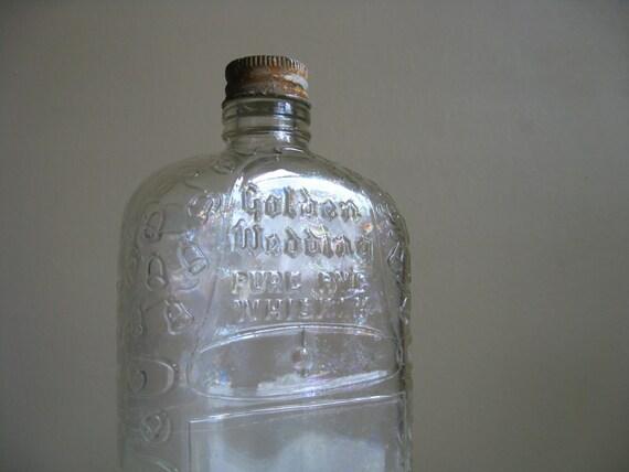 Golden Wedding Pure Rye Whiskey.  Vintage Glass Bottle.