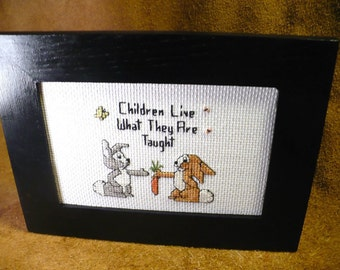 Children Live What They Are Taught Saying - Bunnies Sharing - Framed Hand Stitched Counted Cross Stitch Saying