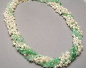 Five strands of pearls and chrysoprase.