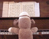 Ernie the Sock Monkey Tickles the Ivory on the Old Piano Notecard