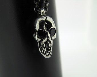 Skullduggery Pendant with gemstone eyes on chain