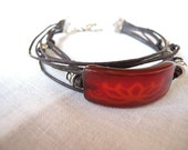 tangerine tango carnelian focal bead - waxed cotton cord multistrand bangle with metal beads