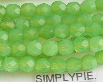 MILKY PERIDOT ..  Czech Beads Fire Polished 4mm 50 Faceted Round GLass