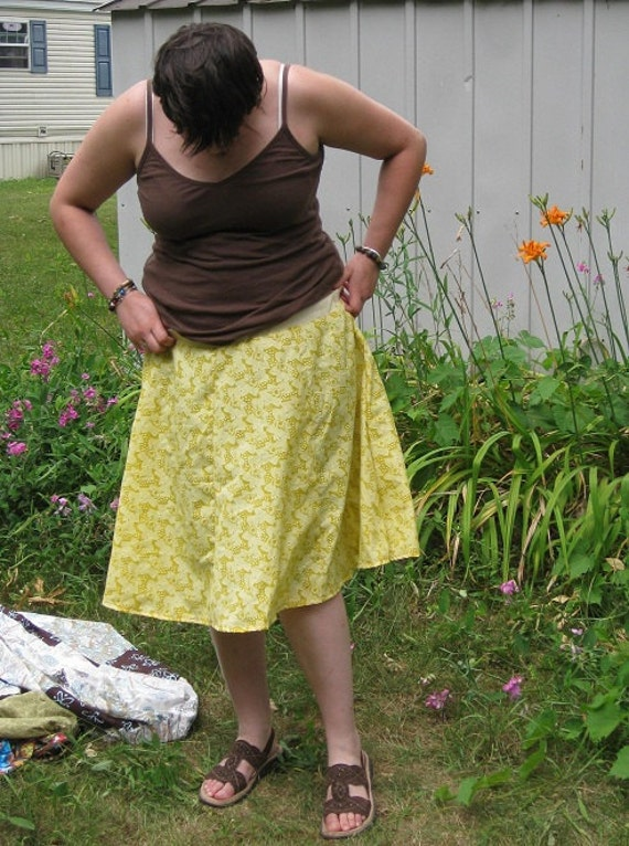 Knee length yellow floral print skirt