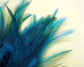 30 Peacock Green Strung Coque Saddle Feathers on Ribbon.