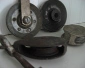collection of vintage pulleys