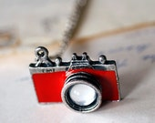 A really cool red Camera necklace