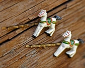 a Charming pair of Wooden Rocking-Horse Hair Pins
