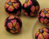 Firey Black Orange and Red Flower with Black and White Spiral Center Polymer Clay Beads (8)