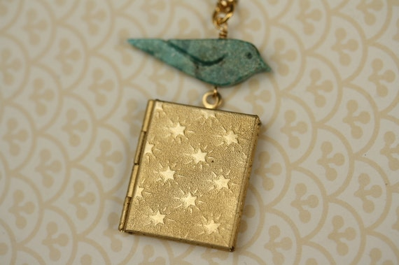 Turquoise Blue Bird and Stars Book Locket Necklace, Long Gold Pendant, Geometric Pattern Jewelry, Whimsical Fashion