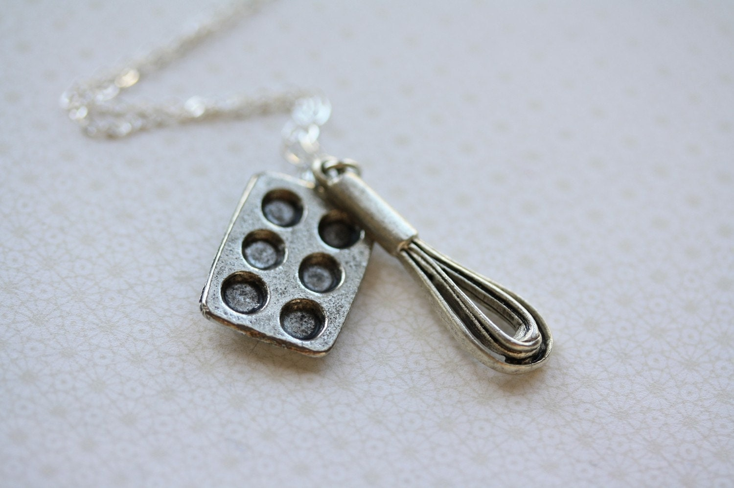 whisk and baking pan necklace on a sterling silver chain