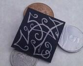 Silver & black brooch