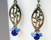 Blue Filigree earrings with a long oval gun metal dangles with floral motifs and carved cobalt blue glass beads and sparkly crystals, noir