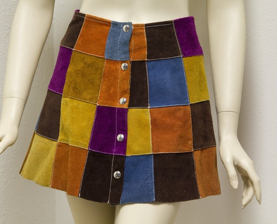 Vintage Suede Patchwork mini skirt with full snap front.