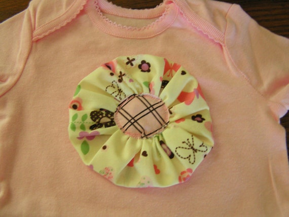 SALE. Pink Ruffle sleeve onesie with flower embellishment