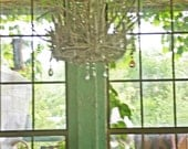 A Chandelier made out of driftwood from a reclaimed vintage brass light fixture. Custom order only