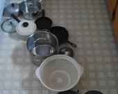 Daughter Art Number Five - Fine art created by a child it is a series of pots and pans lined up deliberately