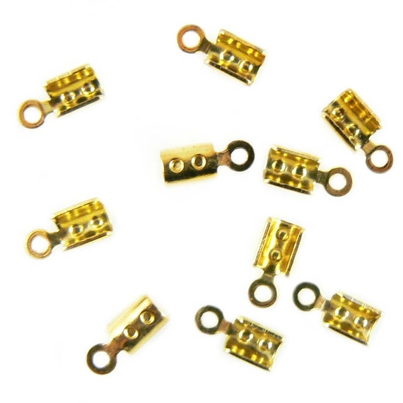 2mm gold plated fold over crimp cord ends, 36 pcs. 2.7mm wide, 4mm fold over flaps, 8.6mm overall length. End for necklaces, bracelets, cord
