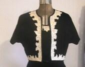 Black velvet sleeveless dress and cropped jacket