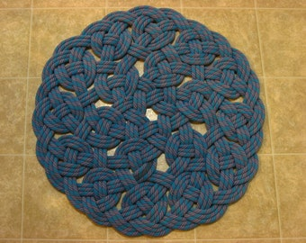 Handwoven Rug Made from (-YOUR-) Recycled Climbing Rope aproximately 27 inch diameter.