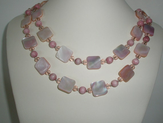 Pink Mother of pearl necklace with Rhodochrosite and pink faceted crystals with free pair of earrings.