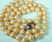MAGNIFICENT MARVELLA vintage Marvella 24 inch strand of hand knotted glass pearls with a sterling silver and smokey quartz clasp