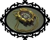 For the Wayward Traveler - a Golden Compass necklace