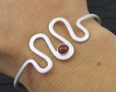 solid sterling silver curvy cuff bracelet. round carnelian cabochon and silver forged cuff bracelet. wavy cuff. handmade by me