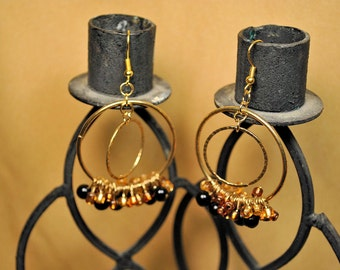Gold hoop earrings with black and gold beading