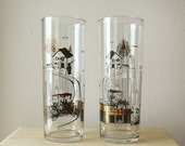 Pair of Vintage Mid Century Modern Gold and Black Tall Bar Glasses with Transportation Theme.