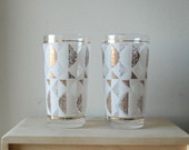 Vintage Pair of Mid Century Modern Drinking Glasses with Gold and White Design.