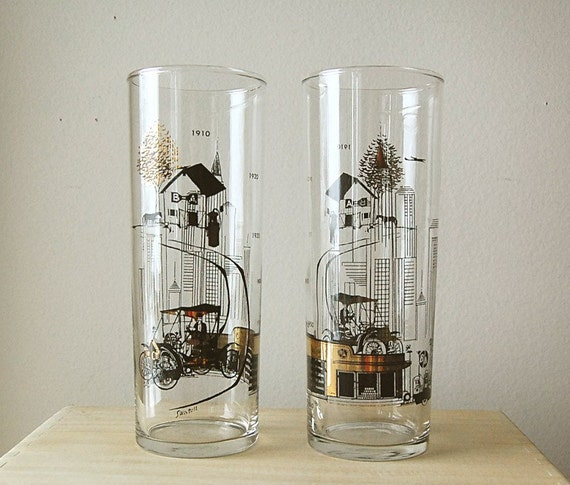 Pair of Vintage Drinking Glasses Mid Century Modern Gold and Black Tall Cocktail Barware with Transportation Theme.