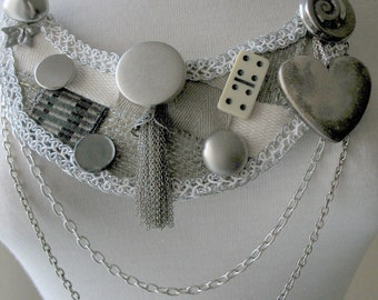 Charms and Symbols Bib Necklace by MaggieGlynn