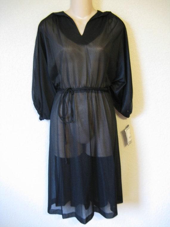 1970's black disco dress. sheer dolman sleeve. small. new old stock.