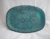 Decorative, turqouise, lace patterned, stoneware platter