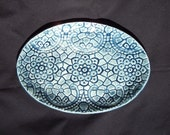 Pastel blue, oval platter with lace decoration