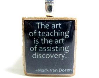 The art of teaching is the art of assisting discovery - black Scrabble tile teacher gift