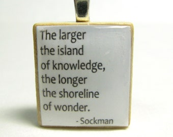 The larger the island of knowledge - white Scrabble tile with Sockman quote