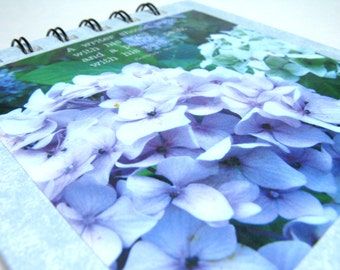 A writer should write with his eyes and a painter paint with his ears - notepad with Gertrude Stein quote and English hydrangeas