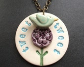 Tweet bird on a flower ceramic pendant
