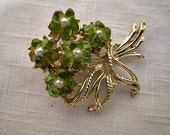 A bouquet of green flowers. Vintage brooch, pin.
