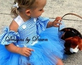 Custom Handmade Inspired Dorothy dress. Corset top, sleeves and tutu skirt. Available in Size 6m-10 Girls