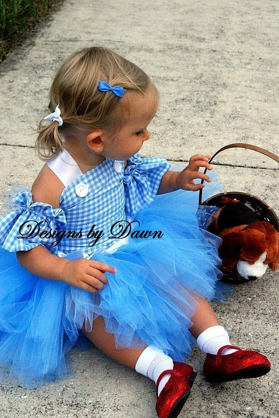 Dorothy style dress. Blue gingham corset top with arm sleeves and tutu skirt. Available in sizes 12m-5T..Custom colors and sizes available