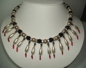 IVORY TRADE - BLACK ONYX AND CREAM PEARL DAGGER DROP NECKLACE