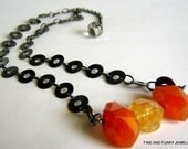 orange carnelian and golden citrine chunks on gunmetal chain