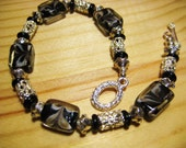Discounted Handmade Bracelet Black and Sparkely Glass beads with Silver Accents, Black and White, Artisan