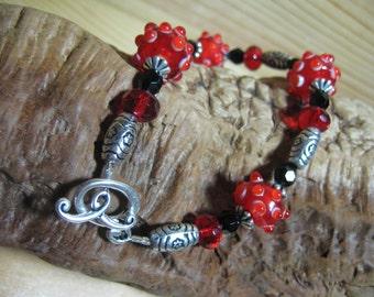 Red Lampwork Bracelet Handmade Sputnik Glass, Black Crystals, Silver Accents
