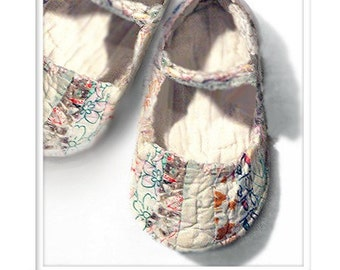 baby mary janes created out of antique wedding ring patterned quilt aka baby shoes