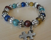 Autism Awareness Bracelet Frosted Glass and Pewter Puzzle Piece